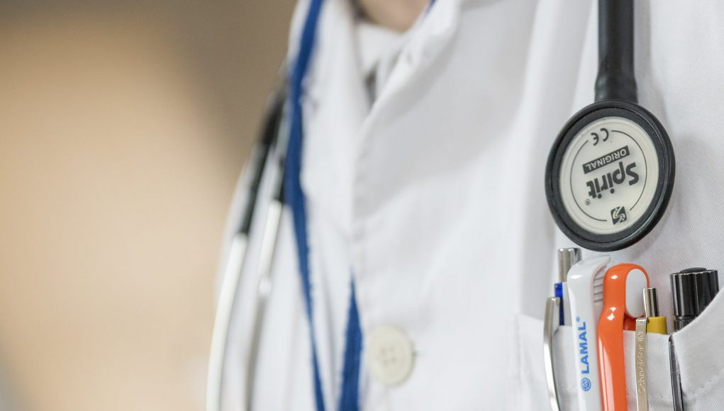 medical center: someone wearing a white coat with a stethascope