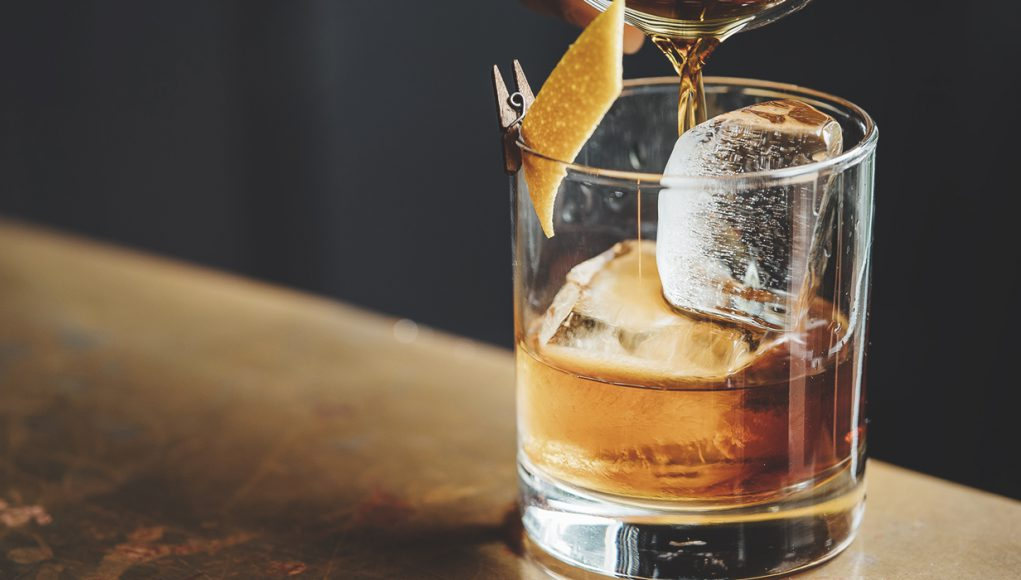 Pappy Van Winkle liquor barn: glass of bourbon with an orange twist