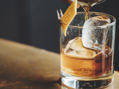 Pappy Van Winkle liquor barn: glass of bourbon with an orange twist