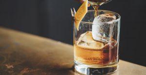 liquor barn: glass of bourbon with an orange twist