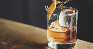 liquor barn: glass of bourbon with an orange twist