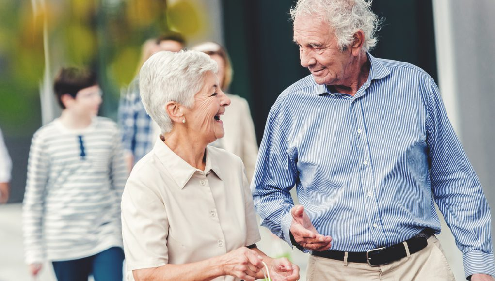 Senior News: an older couple walking and laughing