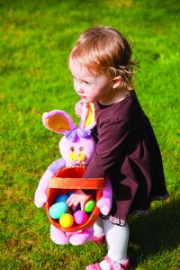 Kid at an Easter egg hunt
