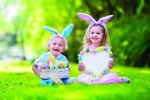 kids holding easter baskets