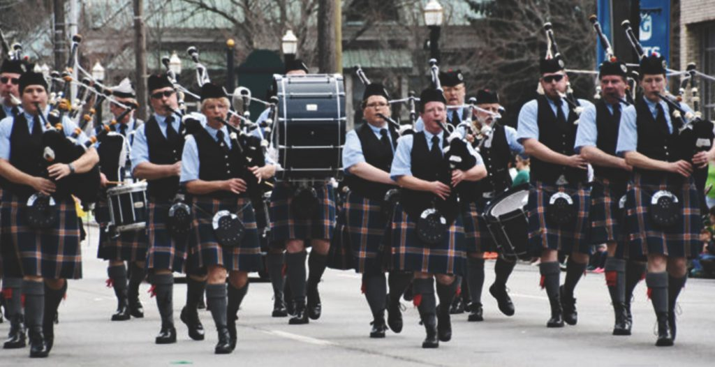 band playing bagpipes in parade