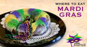 mardi gras: king cake with purple, green, and yellow icing and beads