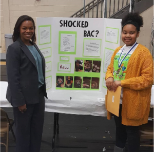 Councilmember Angela Evans with student at 2018 Science Fair