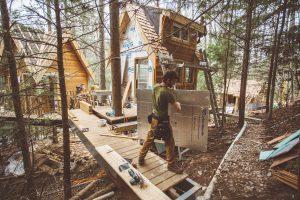 Django Kroner working on a treehouse