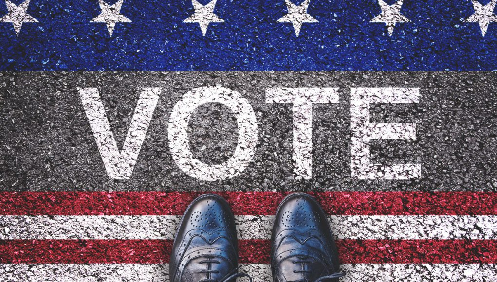 Primary Election Elections: vote written in chalk with blue and red and white and a pair of shoes