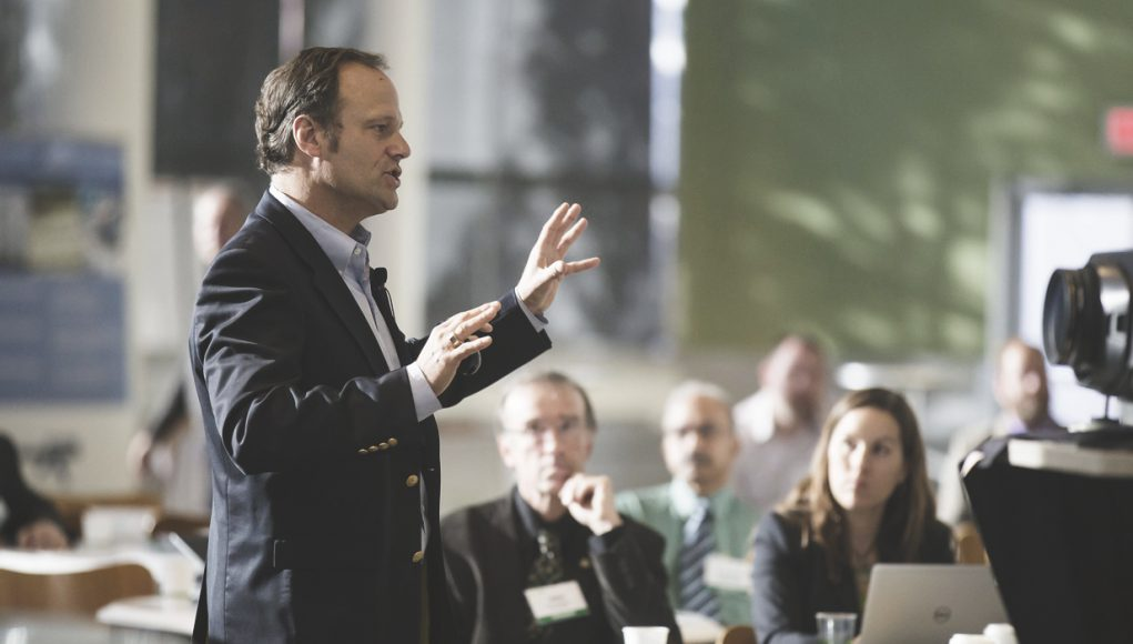 Man giving presentation to group of business people