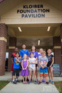 children standing in front of YMCA outdoor pavilion