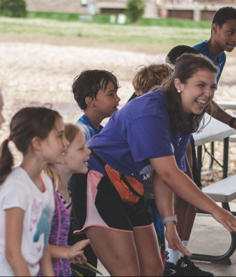 kids dancing with camp counselor