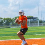 Lexington: a high school football player in an orange uniform