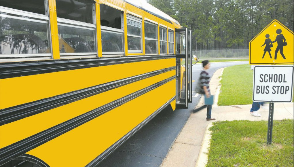 kid stepping off school bus