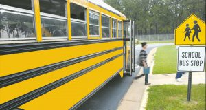 kid stepping off school bus