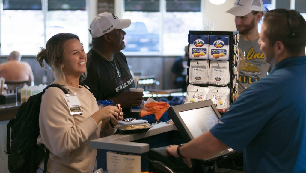 young girl smiling at cashier of Skyline Chili restaurant