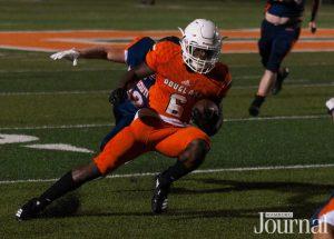 Lexington: high school student playing football in a orange uniform