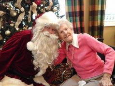 santa claus with elderly woman