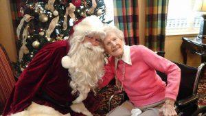 santa claus with elderly woman