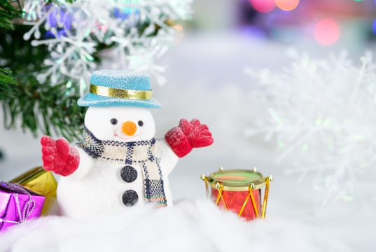 holiday: snowman with red gloves and a drum