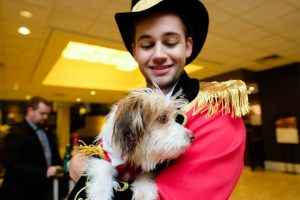 pets: a man dressed as a ring leader with a dog