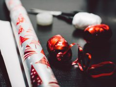 holiday: silver and red wrapping paper with scissors and ribbon
