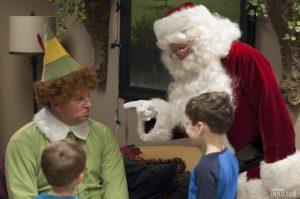 Santa and Buddy talking to a few kids