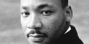 black and white image of martin luther king, jr. looking at the camera