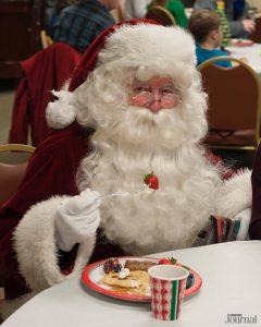 santa claus eating pancakes and fruit