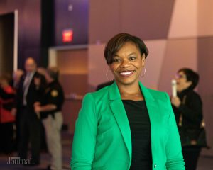 Lexington: woman in a green blazer smiling at the camera