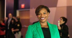 Angela Evans Lexington: woman in a green blazer smiling at the camera