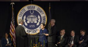 linda gorton and her husban taking her oath of office at the inaugural ceremony