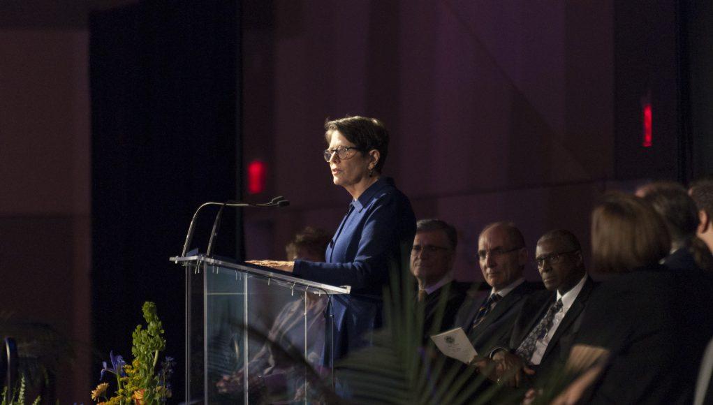 COVID-19 inaugural ceremony: linda gorton at a podium giving a speech