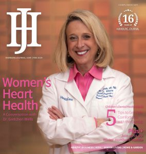 cover: woman in a pink top with a white labcoat smiling at the camera