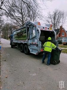 waste: a garbage truck and a waste collector