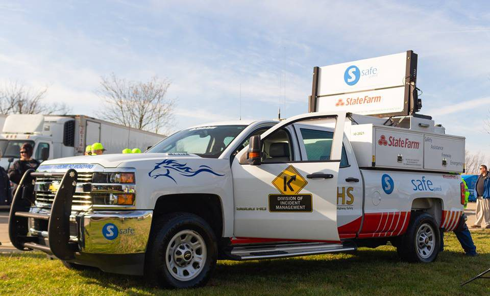 intersections: white truck with logos including the kentucky transportation cabinet