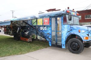parents: a decorated blue bus