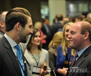 commerce lexington: 2 men talking