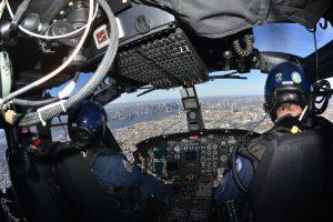two officers in a helicopter delivering krispy kreme