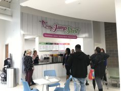 juice bar that says jump start with white walls