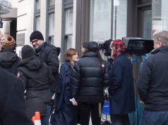 drew barrymore: group of people in jackets talking to each other