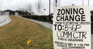 neighborhood: sign that said zoning change