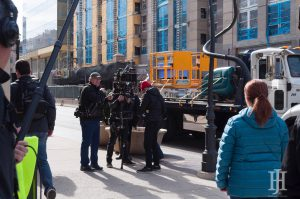 drew barrymore: two men and a woman working with a large camera rig