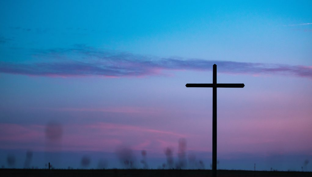 ash wednesday: blue and purple sky with a cross silhouette