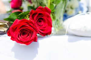 Valentine's Day: red roses on white linen