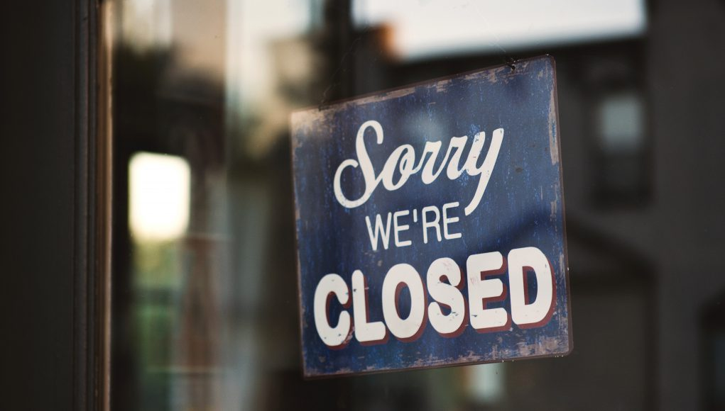rite aid: a sign that says sorry, we're closed