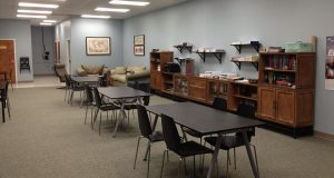 sphinx academy: classroom with tables in the center of the room and counter tops against the wall