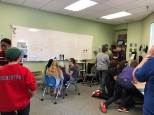 spinx academy: group of kids in a classroom at a white board
