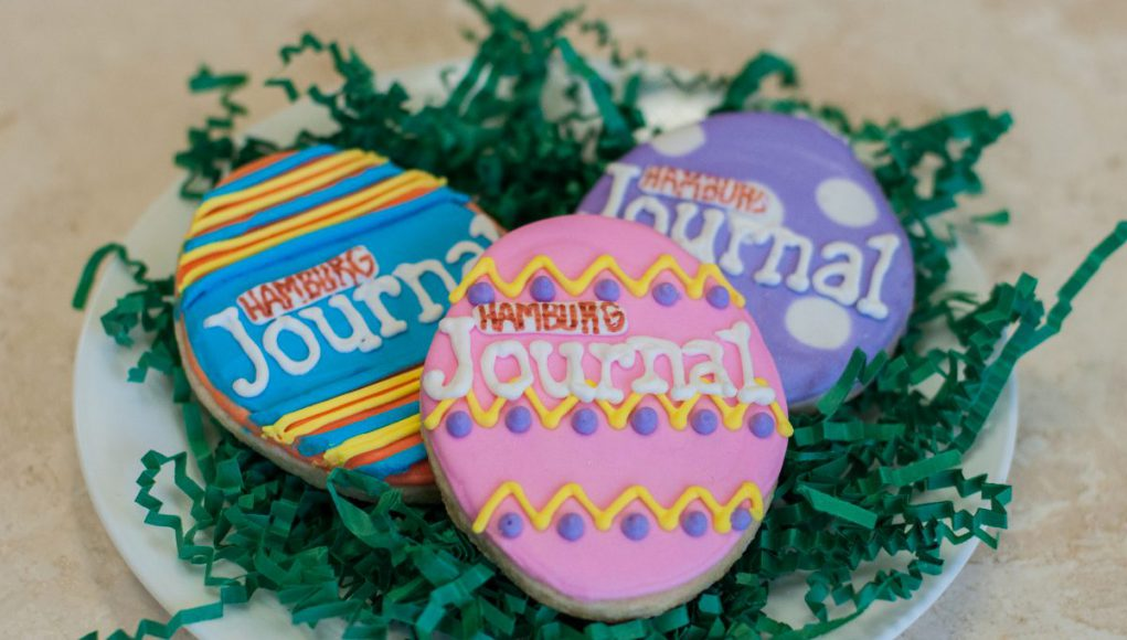 Easter Egg Hunt: cookies in the shape of eggs with colorful icing that says Hamburg Journal