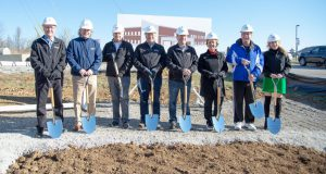 business news: group of people with shovels posing for a picture